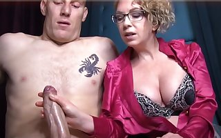Domme T is a horny, platinum-blonde female in a satin tee-shirt who enjoys to give voluptuous handjobs